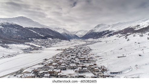Aerial view of Livigno alps ski resort in winter. Valley covered with snow, Italy