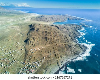 An aerial view of Llanos de Challe National Park, Atacama Desert at the coast area. Amazing landscape like this coastline of the Pacific Ocean at Carrizal Bajo town with it gorges and valleys, Chile