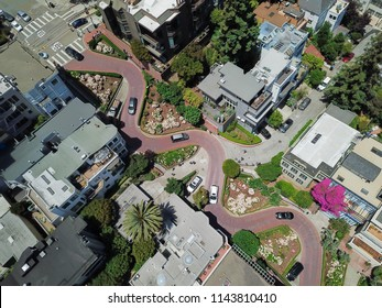 Aerial view Lombard Street, an east–west street in San Francisco, California that is famous for a steep, one-block section with eight hairpin turns. Crookedest, steep hills, sharp curves, one-way road