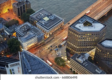 Aerial view of the London Bridge illuminated at dusk in Southwark