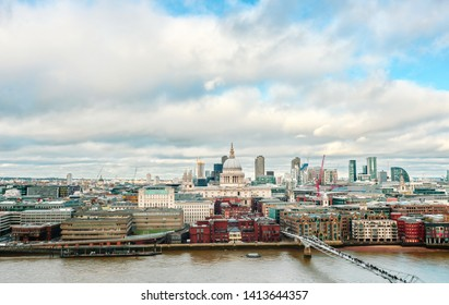 Aerial view of London St Paul's Cathedral with London Millennium Bridge in London England UK