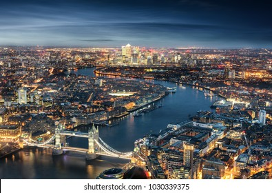 Aerial view of London: from the Tower Bridge to the financial district Canary Wharf during evening time