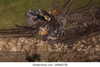 aerial view of long arm excavator working on the field in Poland