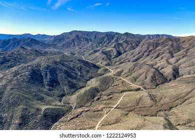 Aerial view of the long and bumpy dirt road leading to Crown KIng, Arizona in the Bradshaw Mountains