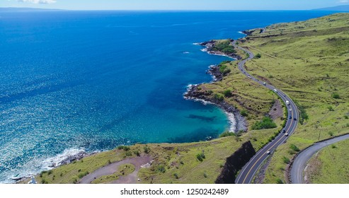 An aerial view of a long coastal highway in West Maui, Hawaii to the south of Lahaina.