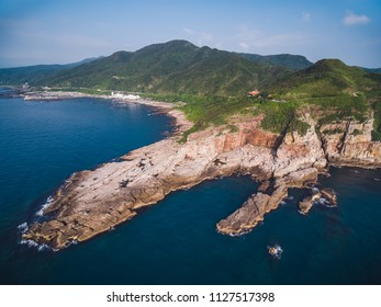 Aerial View of Longdong Bay Cape - Northeast and Yilan Coast National Scenic Area. Coast landscape birds eye view use the drone, shot in Gongliao District, New Taipei, Taiwan.