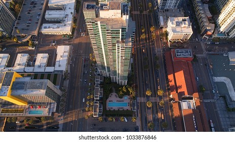Aerial view looking down at a high rise building in downtown