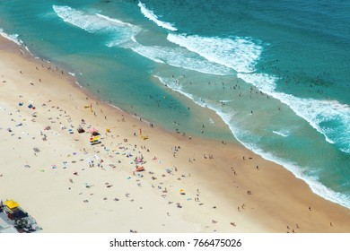 Aerial view looking down on swimmers on Surfers Paradise beach, Gold Coast.