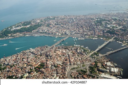 Aerial view looking south across Istanbul across the Golden Horn waterway towards the old city and the Marmara Sea beyond.  Crossing the Golden Horn are the Galata, Ataturk and Halic bridges.