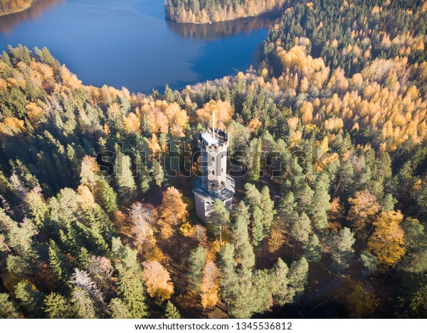 Aerial view of the lookout tower in autumn landscape at Aulanko nature reserve park in Hameenlinna, Finland. Fall colors make trees look beautiful colorful