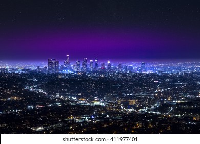 Aerial view of Los Angeles downtown city skyline over the Hollywood at night. LA valley California cityscape night lights