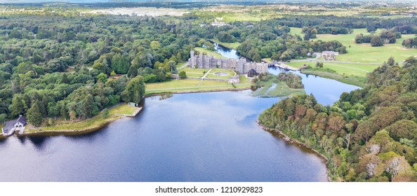 An aerial view of Lough Corrib, in County Galway, Ireland, with Ashford Castle in the background.