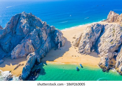 Aerial view of Lovers Beach at Lands End, Cabo San Lucas, Mexico. The side facing the Sea of Cortez is named Lovers Beach while the side facing the Pacific Ocean is named Divorce Beach