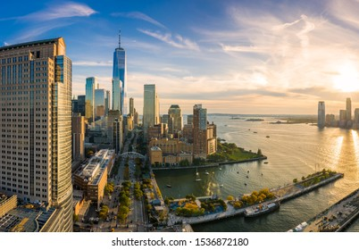 Aerial view of Lower Manhattan skyline at sunset viewed from above West Street in Tribeca neighborhood.