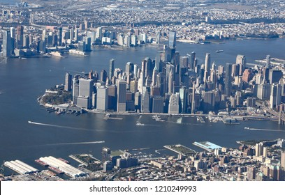 Aerial view of lower Manhattan, with the Wall Street financial district, and Brooklyn, plus the Hudson and East Rivers.
