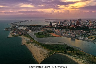 Aerial view from Luanda, capital of Angola, dramatic sunset sky.