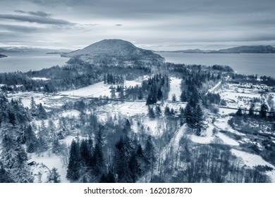 Aerial View of Lummi Island, Washington After a Winter Snowstorm. A snowy landscape is rare in the Salish Sea area of western Washington state.