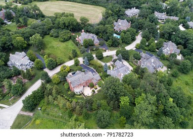 Aerial view of a luxury neighborhood with mature trees and large lots in a Chicago suburban neighborhood in summer. Lake Forest, IL. USA