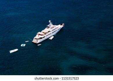 Aerial view of a luxury yacht on a turquoise and transparent sea. Emerald Coast, Mediterranean sea, Sardinia, Italy.