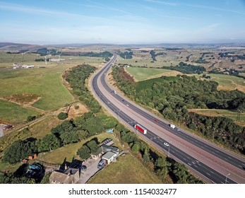 Aerial view of the M62 going towards Manchester at Pole Moor, West Yorkshire, UK