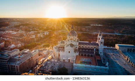 Aerial view of Madrid Cathedral Santa Maria la Real de La Almudena in Madrid, Spain and Royal Palace at sunset. Architecture and landmark of Madrid. Cityscape of Madrid