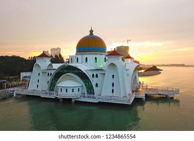 Aerial view of Majestic Malacca Straits Mosque during sunset