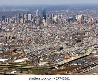 Aerial view of major American city Philadelphia Pennsylvania with Downtown Center City commercial business district and residential South Philly area with highway interstate I-95 in foreground