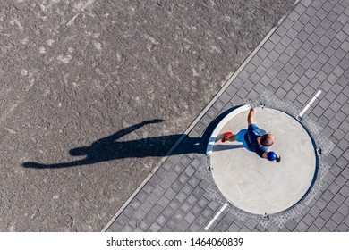 aerial view of a man in shot put in track and field