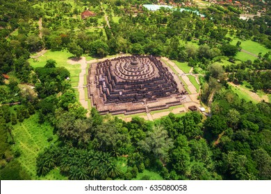 Aerial view of the mandala-shaped Borobudur temple, the world's largest Buddhist monument, in Central Java, Indonesia.