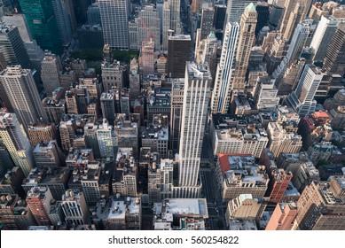 Aerial view of Manhattan midtown skyscrapers. Urban jungle background. Overpopulation concept
