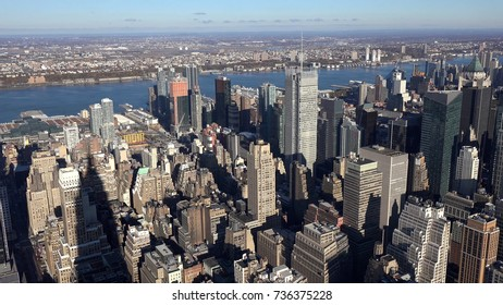 Aerial view of Manhattan skyline with panorama view of urban skyscrapers in the day, New York City, USA