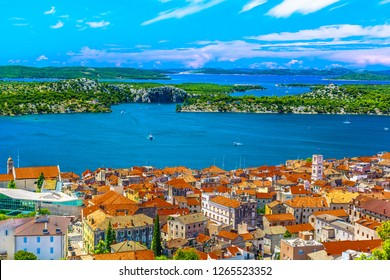 Aerial view at marble idyllic summer town Sibenik in Croatia, famous travel destination. / Selective focus.