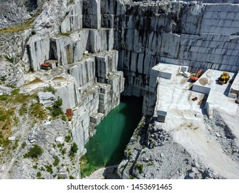 Aerial view of a marble quarry with a pond