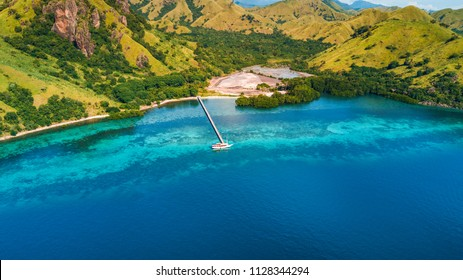 Aerial view of Marijite Bridge, a wooden pier in front of the private island from Komodo Island (Komodo National Park), Labuan Bajo, Flores, Indonesia