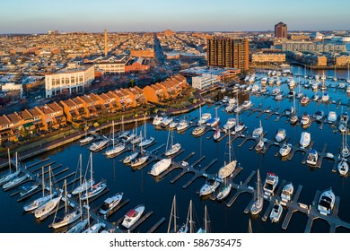 Aerial view of a marina and buildings along the Canton Waterfront at sunset, in Baltimore, Maryland.