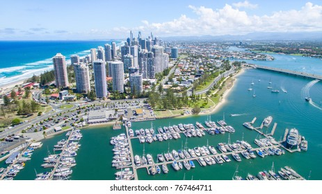 Aerial view from Marina Mirage harbour and yachts, with a view over to Main Beach and Surfers Paradise cityscape