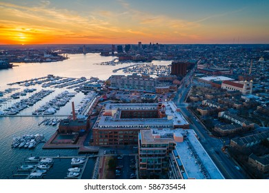 Aerial view of marinas and buildings along the Canton Waterfront at sunset, in Baltimore, Maryland.