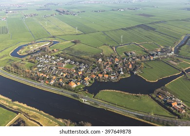 Aerial view of Markenbinnen, Netherlands. A typical dutch village with a forttress from the STELLING VAN AMSTERDAM in the left side of the picture.