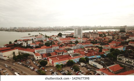 Aerial view Market of Tulhas and historical buildings decorated by the government with flags of sao joao in the center of the city of sao luis do maranhao, brazil