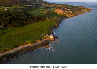 Aerial view of a Martello tower on the Howth coastline.