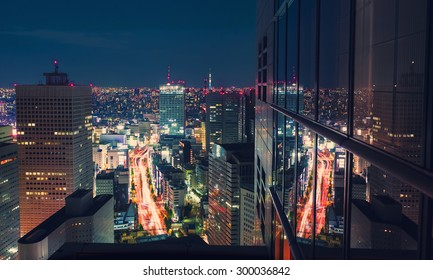 Aerial view of a massive highway intersection at night in Shinjuku, Tokyo, Japan from a skyscraper