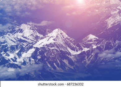 aerial view massive snow mountain range with violet sunlight at Leh Ladakh, India