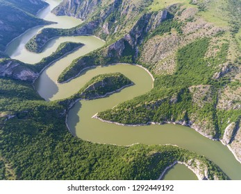 Aerial view of meanders at rocky river Uvac gorge on sunny day, southwest Serbia