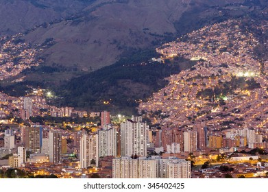 Aerial view of Medellin at night with residential and office buildings. Colombia