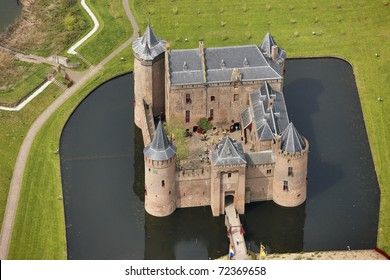Aerial view of the medieval castle Muiderslot in the town of Muiden, Holland