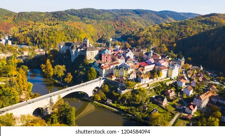 Aerial view of medieval town Loket nad Ohri near Karlovy Vary spa in Czech Republic. Historical city with castle from 12th century. Stunning scenic view of beautiful cityscape with nature.