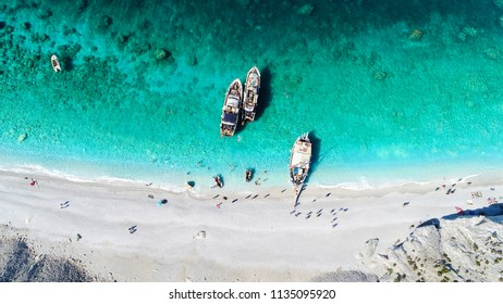 Aerial view from a mediterranean beach with tourist boats