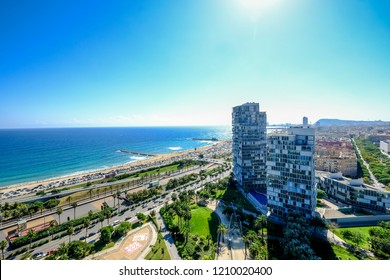 Aerial view of the Mediterranean beaches and modern buildings of Barcelona in the area of Diagonal Mar Catalonia Spain