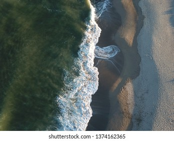 Aerial view of mediterranean sea and waves on beach of Roussillon in eastern pyrenean, France