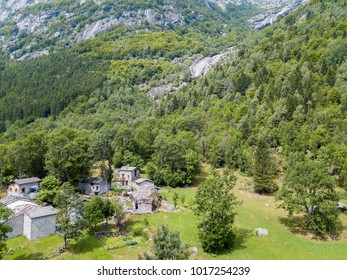 Aerial view of the Mello Valley, Val di Mello, a green valley surrounded by granite mountains and forest trees, renamed the little italian Yosemite Valley by the nature lovers. Italy